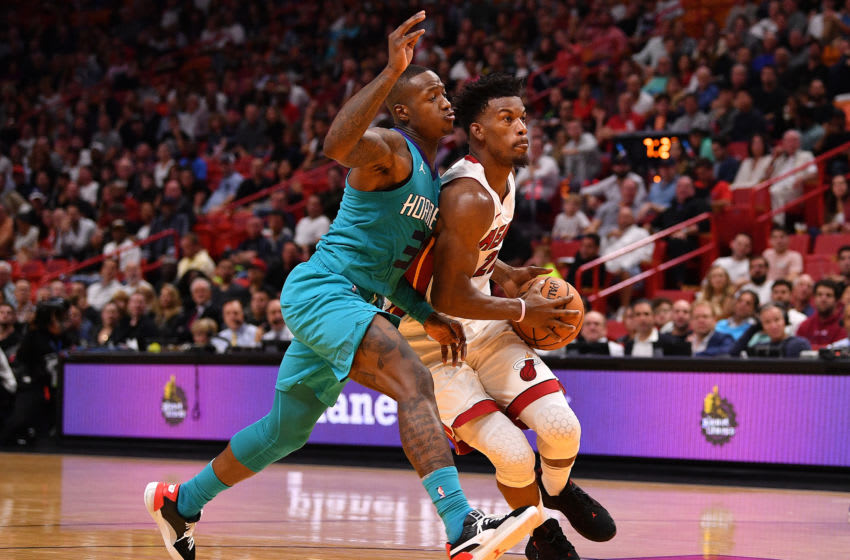 Terry Rozier #3 of the Charlotte Hornets in action against Jimmy Butler #22 of the Miami Heat (Photo by Mark Brown/Getty Images)