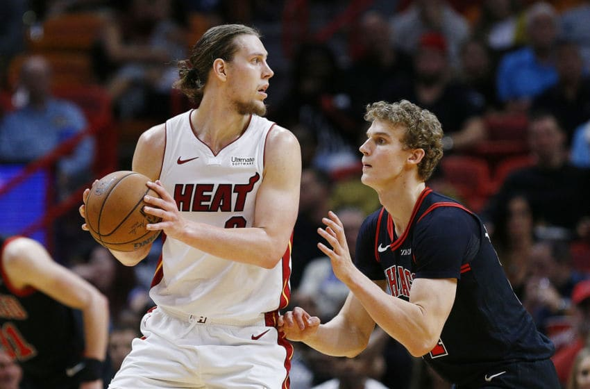 Kelly Olynyk #9 of the Miami Heat is defended by Lauri Markkanen #24 of the Chicago Bulls. (Photo by Michael Reaves/Getty Images)