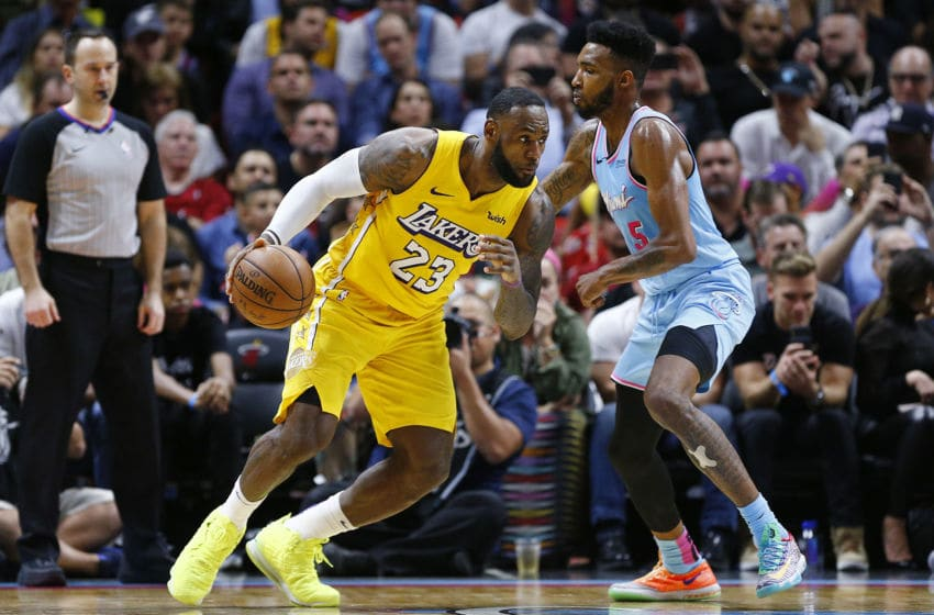 LeBron James #23 of the Los Angeles Lakers drives to the basket against Derrick Jones Jr. #5 of the Miami Heat (Photo by Michael Reaves/Getty Images)