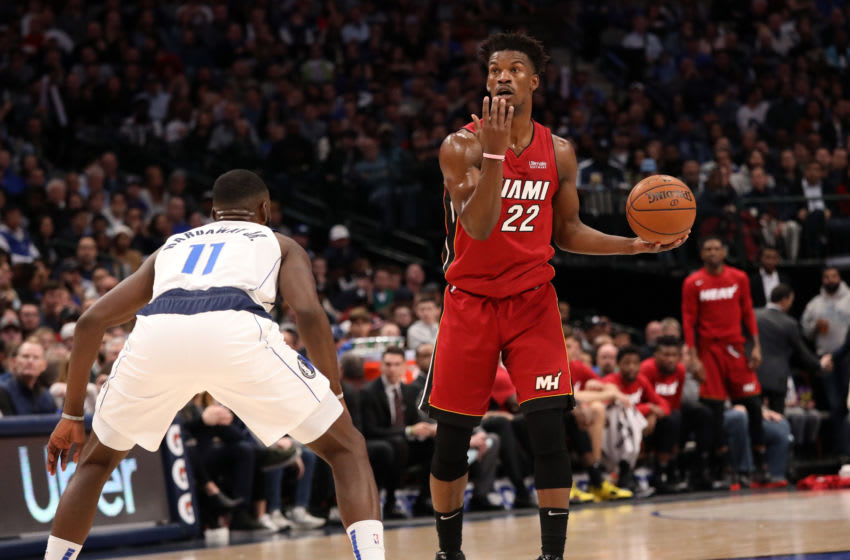 Jimmy Butler #22 of the Miami Heat dribbles the ball against Tim Hardaway Jr. #11 of the Dallas Mavericks (Photo by Ronald Martinez/Getty Images)