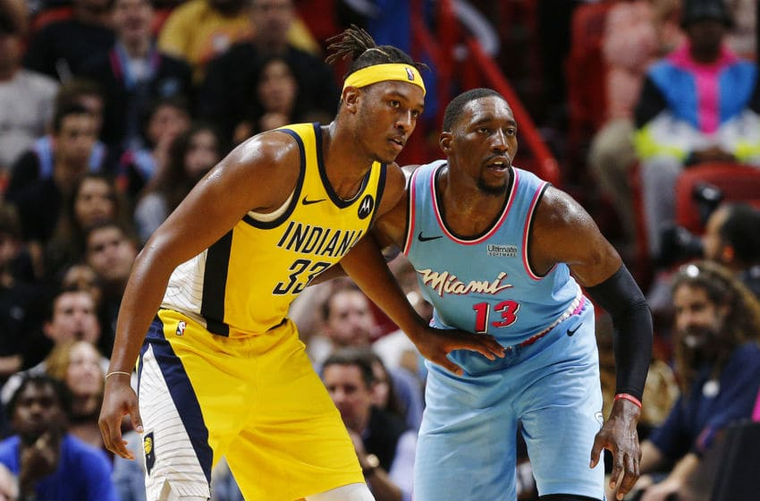 Myles Turner #33 of the Indiana Pacers is defended by Bam Adebayo #13 of the Miami Heat. (Photo by Michael Reaves/Getty Images)