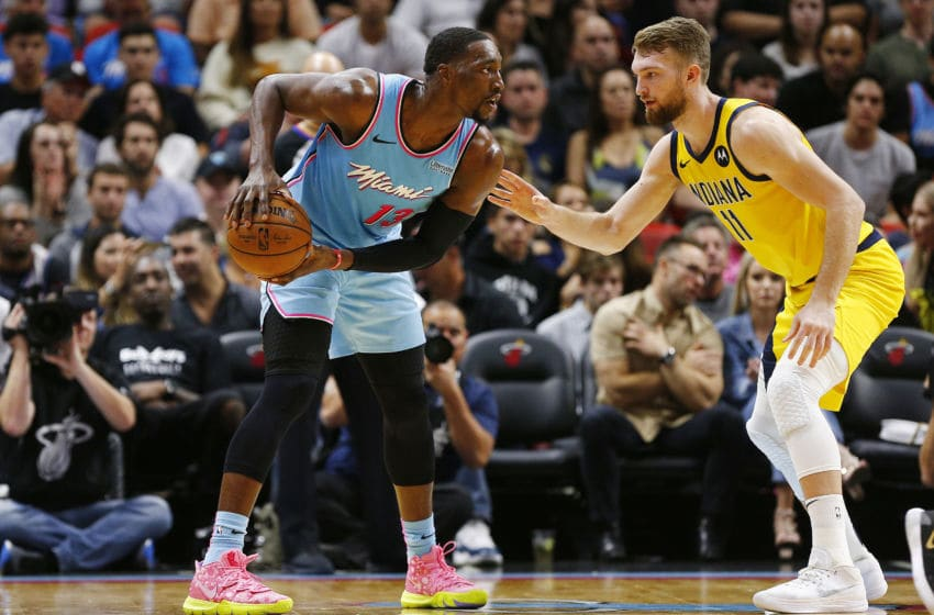 Bam Adebayo #13 of the Miami Heat is defended by Domantas Sabonis #11 of the Indiana Pacers (Photo by Michael Reaves/Getty Images)