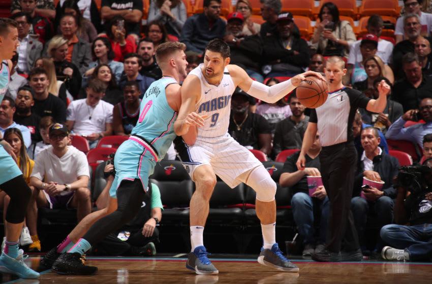 Nikola Vucevic #9 of the Orlando Magic posts up on Meyers Leonard #0 of the Miami Heat(Photo by Issac Baldizon/NBAE via Getty Images)