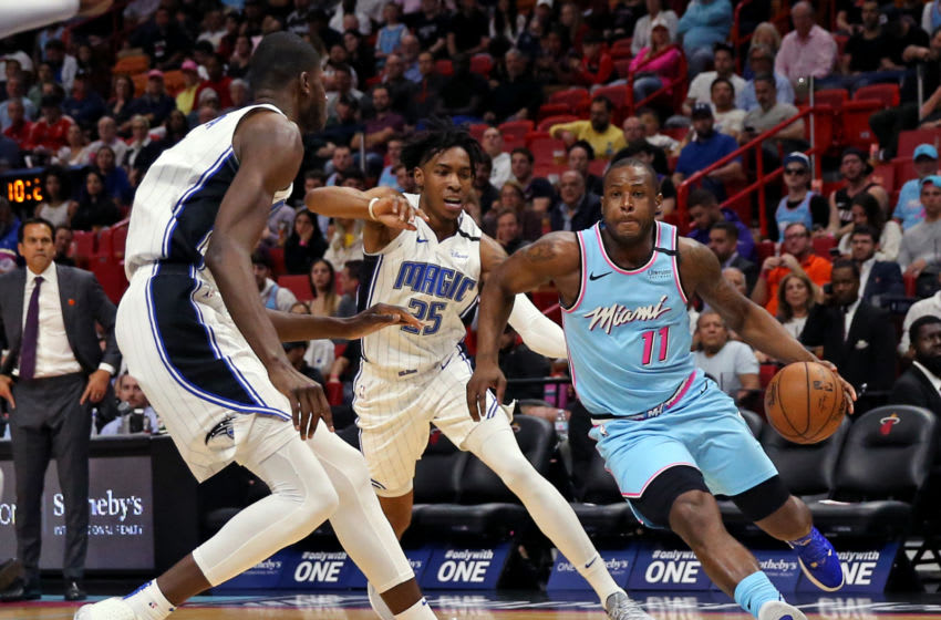 Miami Heat guard Dion Waiters (11) drives against Orlando Magic forward Wes Iwundu (25) and Mo Bamba (5) in the second quarter of an NBA basketball regular season game at the AmericanAirlines Arena(David Santiago/Miami Herald/Tribune News Service via Getty Images)