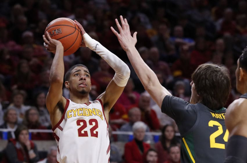 Tyrese Haliburton #22 of the Iowa State Cyclones takes a short over Matthew Mayer #24 of the Baylor Bears (Photo by David Purdy/Getty Images)