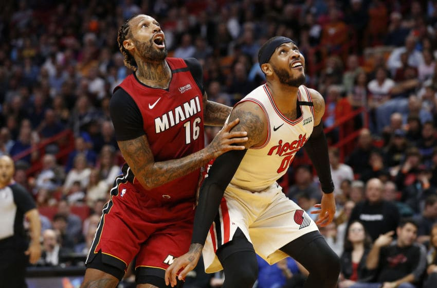 James Johnson #16 of the Miami Heat battles with Carmelo Anthony #00 of the Portland Trail Blazers (Photo by Michael Reaves/Getty Images)