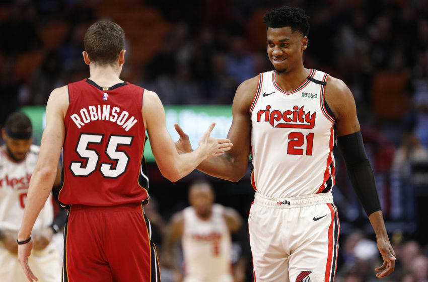 Duncan Robinson #55 of the Miami Heat greets Hassan Whiteside #21 of (Photo by Michael Reaves/Getty Images)
