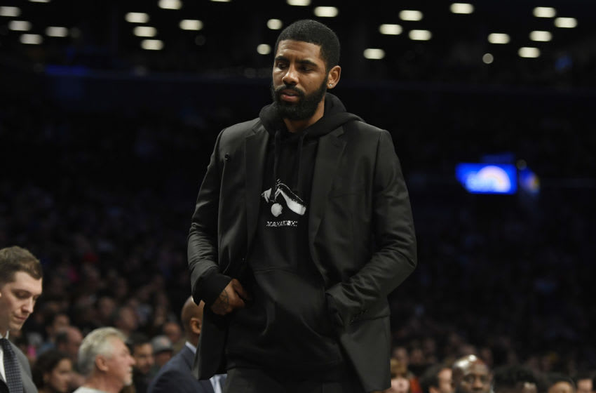 Kyrie Irving #11 of the Brooklyn Nets looks on from the bench (Photo by Sarah Stier/Getty Images)