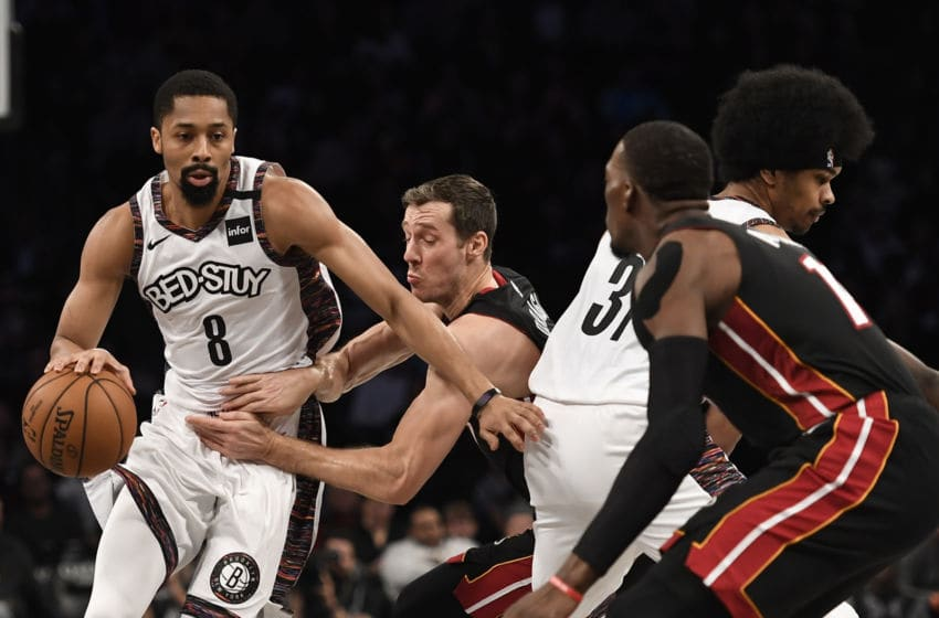 Spencer Dinwiddie #8 of the Brooklyn Nets dribbles the ball as Goran Dragic #7 of the Miami Heat defends. (Photo by Sarah Stier/Getty Images)
