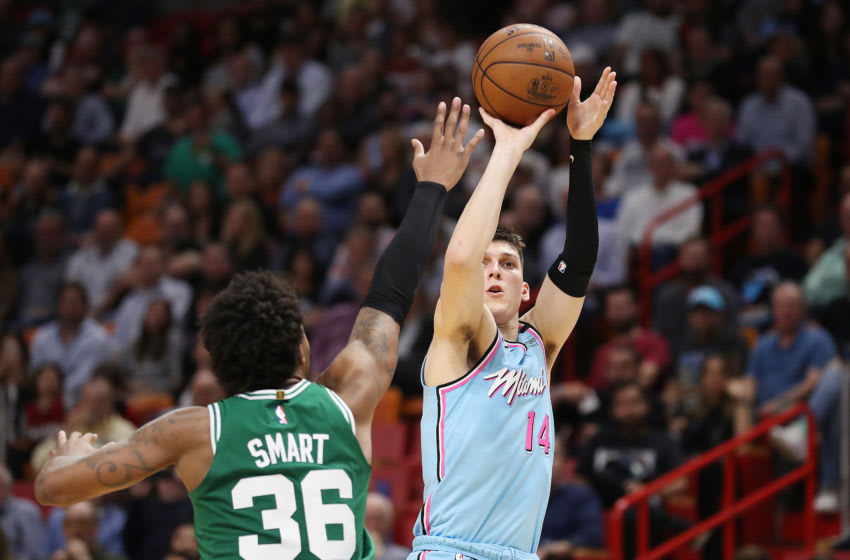 Tyler Herro #14 of the Miami Heat shoots a three pointer over Marcus Smart #36 of the Boston Celtics (Photo by Michael Reaves/Getty Images)