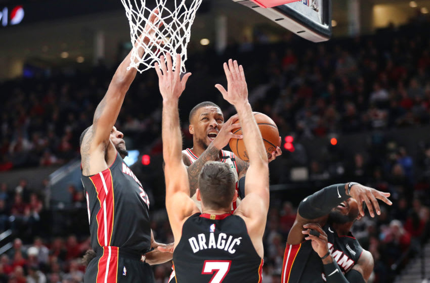 Damian Lillard #0 of the Portland Trail Blazers takes a shot against Andre Iguodala #28 (L), Goran Dragic #7 and Jae Crowder #99 of the Miami Heat (Photo by Abbie Parr/Getty Images)