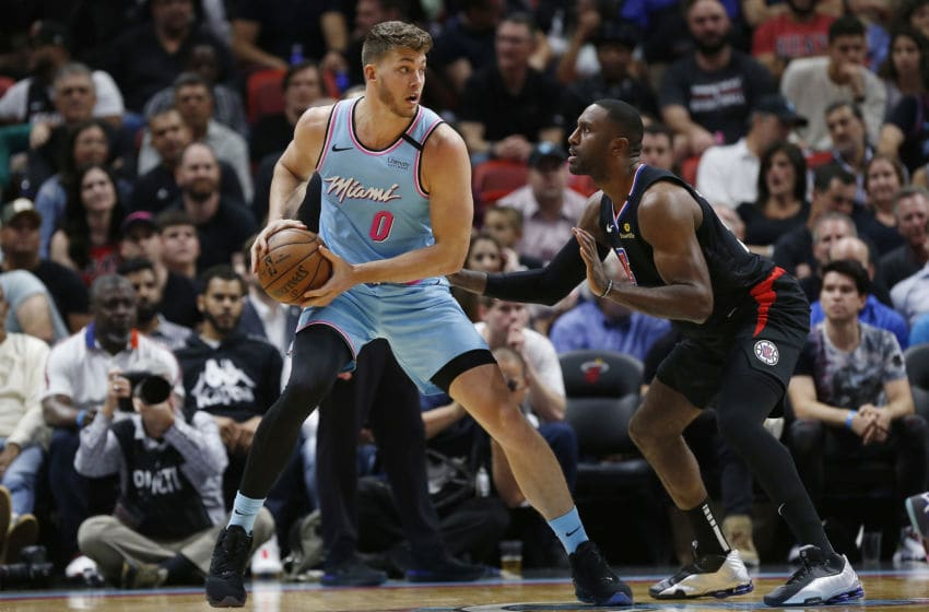 Meyers Leonard #0 of the Miami Heat is defended by Patrick Patterson #54 of the LA Clippers (Photo by Michael Reaves/Getty Images)
