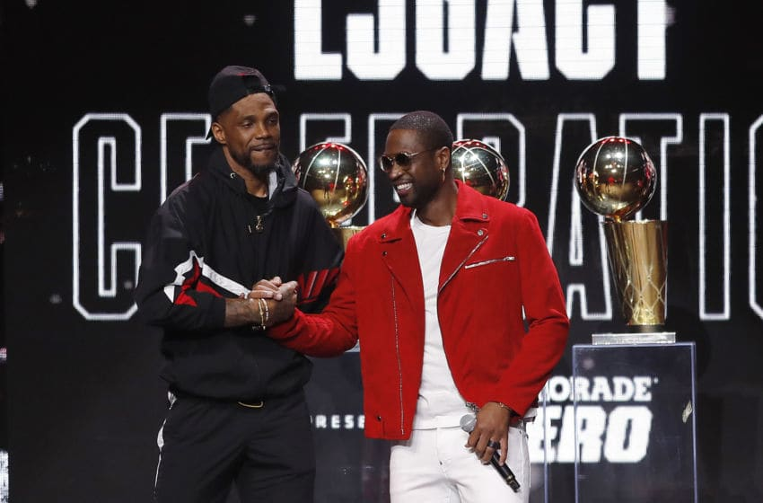 Former Miami Heat player Dwyane Wade greets Udonis Haslem during the Miami Heat Dwyane Wade L3GACY Celebration at American Airlines Arena (Photo by Michael Reaves/Getty Images)