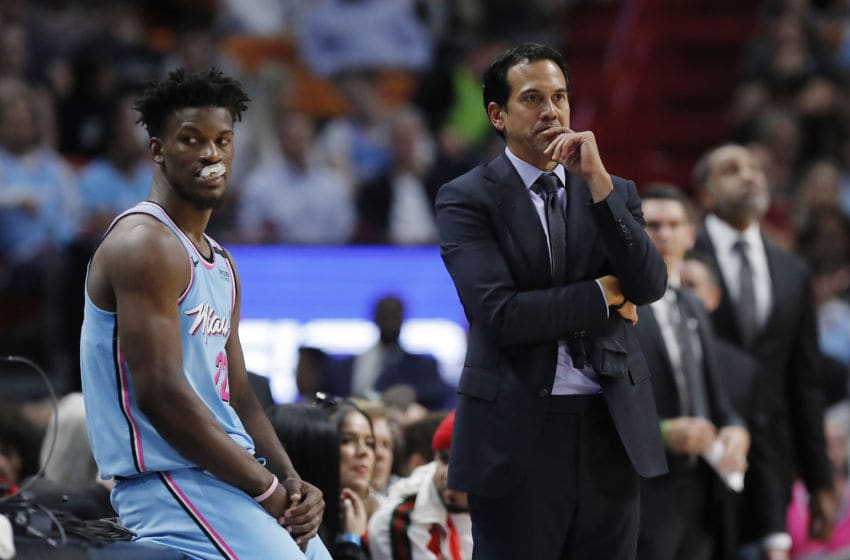 Head coach Erik Spoelstra of the Miami Heat talks with Jimmy Butler #22. (Photo by Michael Reaves/Getty Images)