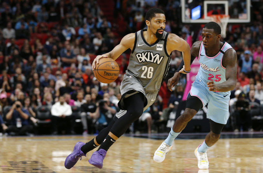 Spencer Dinwiddie #26 of the Brooklyn Nets drives to the basket past Kendrick Nunn #25 of the Miami Heat. (Photo by Michael Reaves/Getty Images)