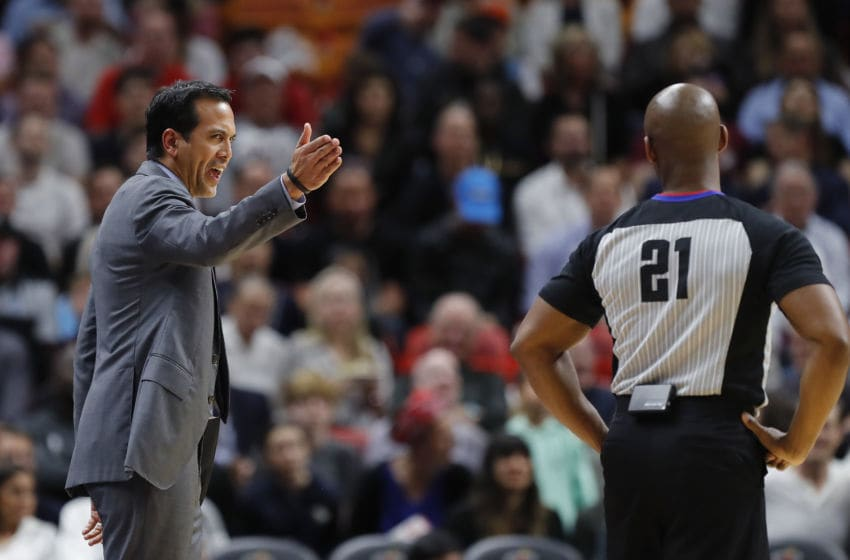 Head coach Erik Spoelstra of the Miami Heat argues a foul call with referee Dedric Taylor #21 against the Milwaukee Bucks (Photo by Michael Reaves/Getty Images)