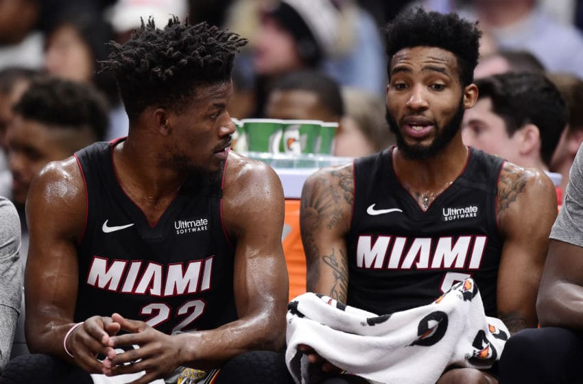 Jimmy Butler #22 and Derrick Jones Jr. #5 of the Miami Heat talk as they sit on the bench (Photo by Patrick McDermott/Getty Images)