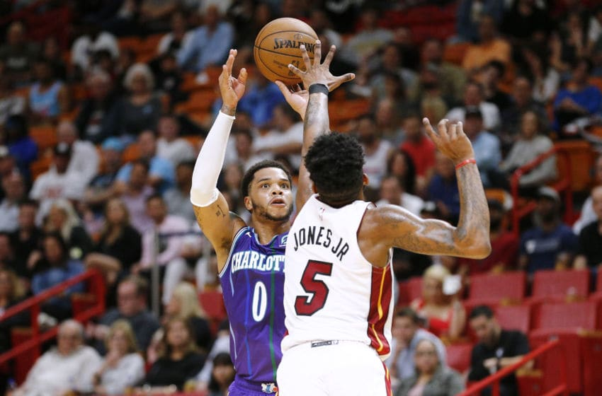 Miles Bridges #0 of the Charlotte Hornets shoots a three pointer over Derrick Jones Jr. #5 of the Miami Heat (Photo by Michael Reaves/Getty Images)