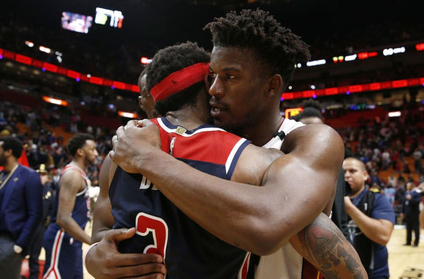 Jimmy Butler #22 of the Miami Heat hugs Bradley Beal #3 of the Washington Wizards after the game. (Photo by Michael Reaves/Getty Images)