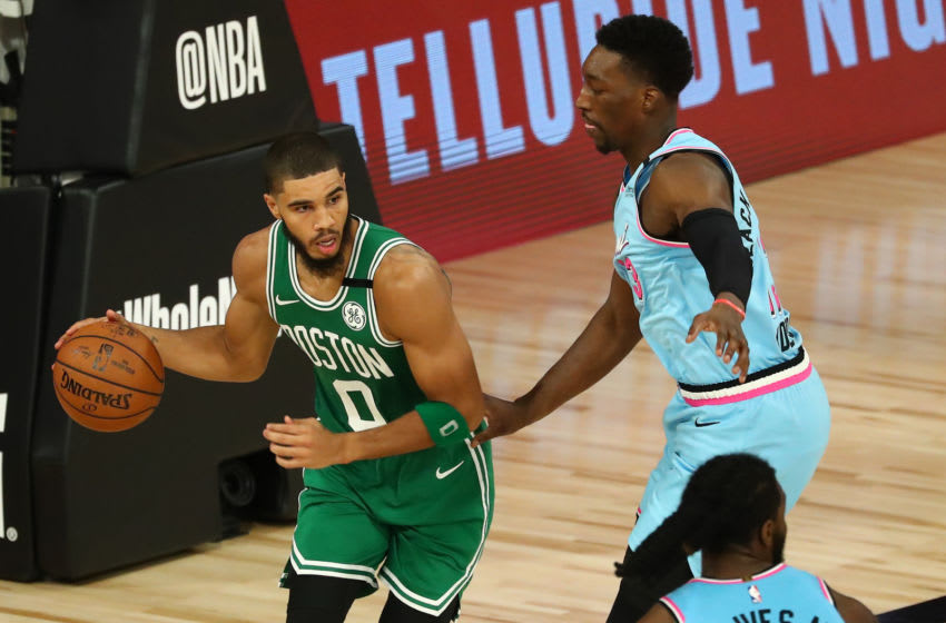 Jayson Tatum #0 of the Boston Celtics controls the ball against Bam Adebayo #13 of the Miami Heat in the second half of an NBA game. (Photo by Kim Klement - Pool/Getty Images)