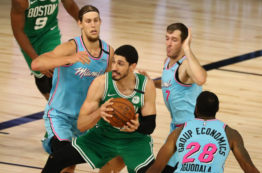 Enes Kanter #11 of the Boston Celtics drives against Kelly Olynyk #9, Goran Dragic #7 and Andre Iguodala #28 of the Miami Heat (Photo by Kim Klement - Pool/Getty Images)