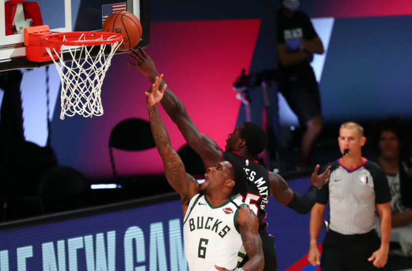 Miami Heat guard Kendrick Nunn #25 blocks a shot against Milwaukee Bucks guard Eric Bledsoe #6 during the first half (Photo by Kim Klement-Pool/Getty Images)