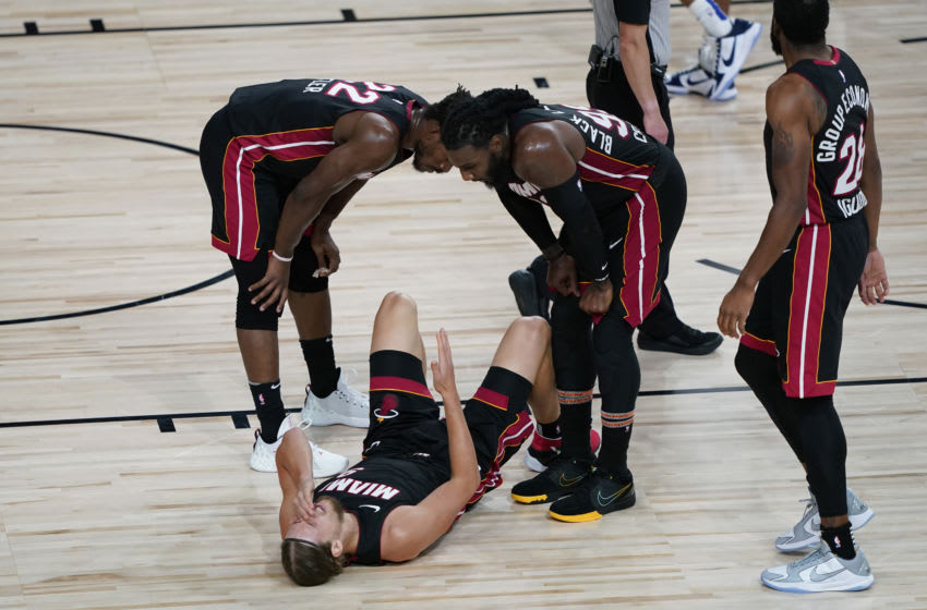 Kelly Olynyk #9 of the Miami Heat is checked on by teammates during the second half of Game Three (Photo by Ashley Landis-Pool/Getty Images)
