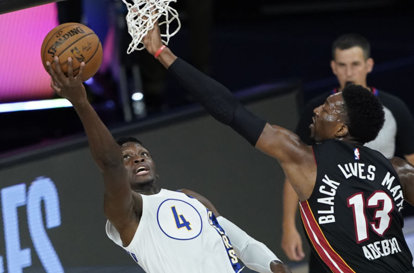 Victor Oladipo #4 of the Indiana Pacers shoots around Bam Adebayo #13 of the Miami Heat during the first half. (Photo by Ashley Landis-Pool/Getty Images)