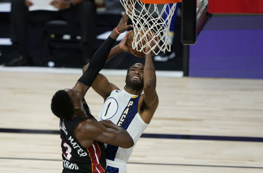 T.J. Warren #1 of the Indiana Pacers shoots over Bam Adebayo #13 of the Miami Heat (Photo by Ashley Landis-Pool/Getty Images)