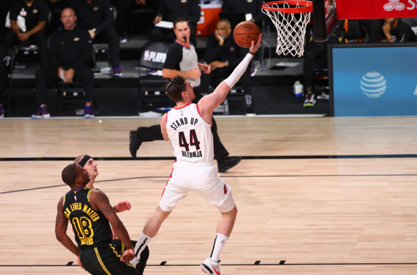 Mario Hezonja #44 of the Portland Trail Blazers drives to the basket against Alex Caruso #4 and Dion Waiters #18 of the Los Angeles Lakers (Photo by Kim Klement-Pool/Getty Images)