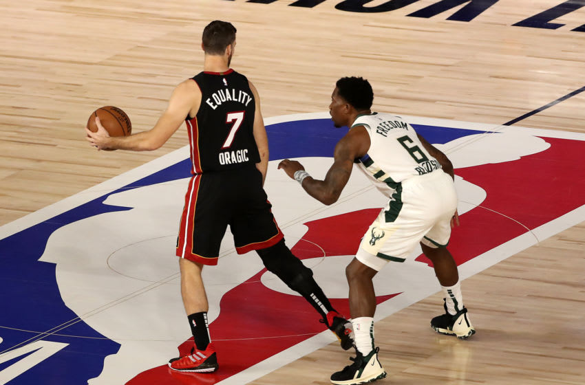 Eric Bledsoe #6 of the Milwaukee Bucks defends against Goran Dragic #7 of the Miami Heat (Photo by Mike Ehrmann/Getty Images)