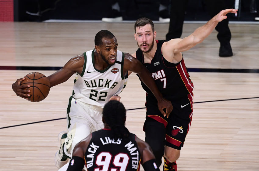 Khris Middleton #22 of the Milwaukee Bucks drives the ball against Goran Dragic #7 of the Miami Heat during the third quarter in Game Four of the Eastern Conference Second Round. (Photo by Douglas P. DeFelice/Getty Images)