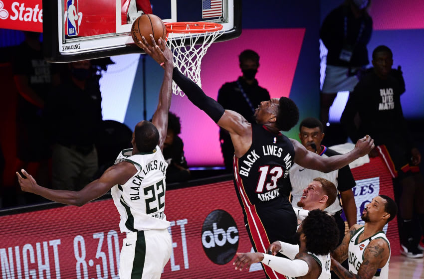 Khris Middleton #22 of the Milwaukee Bucks blocks a shot by Bam Adebayo #13 of the Miami Heat during overtime in Game Four. (Photo by Douglas P. DeFelice/Getty Images)