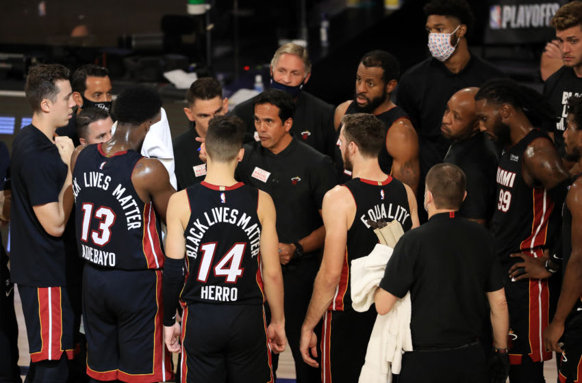 Erik Spoelstra of the Miami Heat talks with his team during the fourth quarter against the Milwaukee Bucks in Game Five of the Eastern Conference Second Round (Photo by Mike Ehrmann/Getty Images)