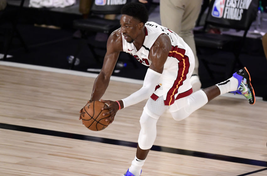 Bam Adebayo #13 of the Miami Heat drives the ball against the Boston Celtics (Photo by Douglas P. DeFelice/Getty Images)