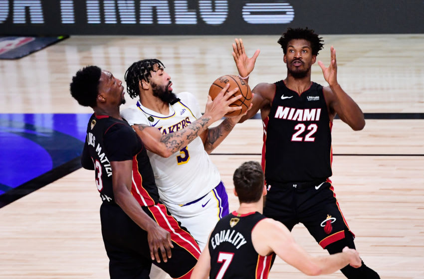 Jimmy Butler #22 of the Miami Heat and Bam Adebayo #13 of the Miami Heat defend Anthony Davis #3 (Photo by Douglas P. DeFelice/Getty Images)