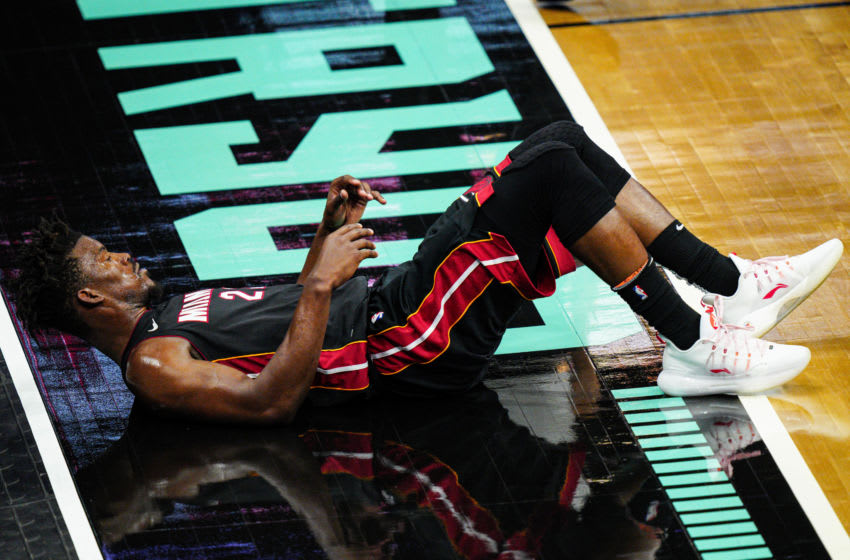 Jimmy Butler #22 of the Miami Heat lays on the ground after being fouled (Photo by Jacob Kupferman/Getty Images)