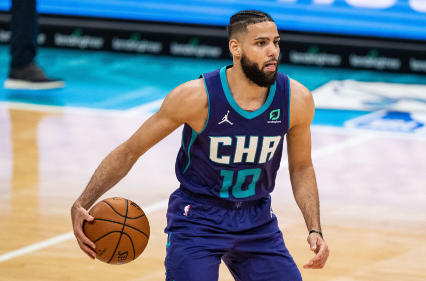CHARLOTTE, NORTH CAROLINA - APRIL 11: Caleb Martin #10 of the Charlotte Hornets brings the ball up court against the Atlanta Hawks in the second half during their game at Spectrum Center on April 11, 2021 in Charlotte, North Carolina. NOTE TO USER: User expressly acknowledges and agrees that, by downloading and or using this photograph, User is consenting to the terms and conditions of the Getty Images License Agreement. (Photo by Jacob Kupferman/Getty Images)
