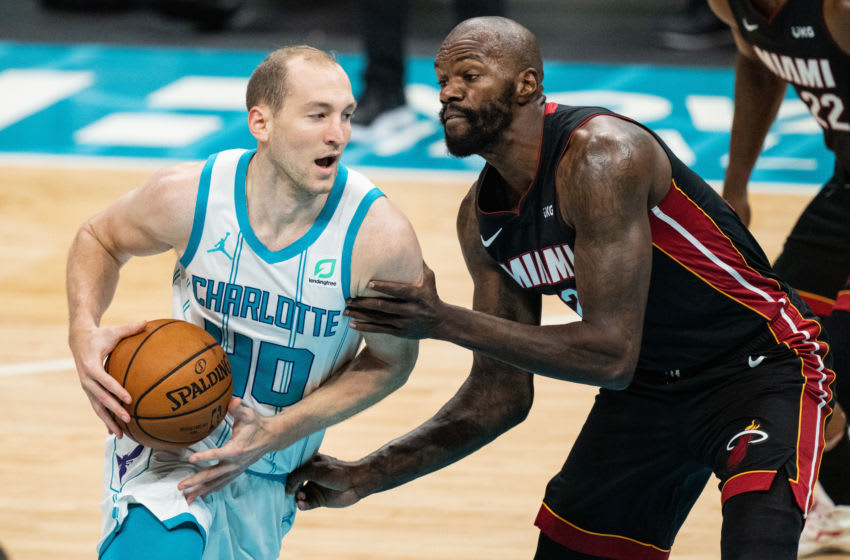 Cody Zeller #40 of the Charlotte Hornets drives to the basket against Dewayne Dedmon #21 of the Miami Heat (Photo by Jacob Kupferman/Getty Images)