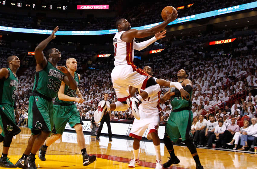 Dwyane Wade #3 of the Miami Heat drives for a shot attempt in the second half against Paul Pierce #34 of the Boston Celtics in Game One of the Eastern Conference Finals (Photo by Mike Ehrmann/Getty Images)