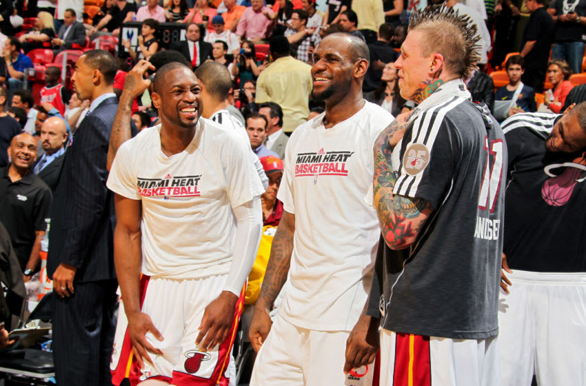 LeBron James #6 of the Miami Heat shares a laugh with teammates Dwyane Wade #3 and Chris Andersen #11 (Photo by Issac Baldizon/NBAE via Getty Images)