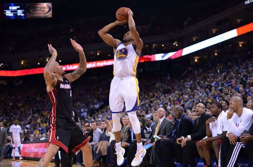 Andre Iguodala #9 of the Golden State Warriors shoots over Michael Beasley #8 of the Miami Heat (Photo by Thearon W. Henderson/Getty Images)