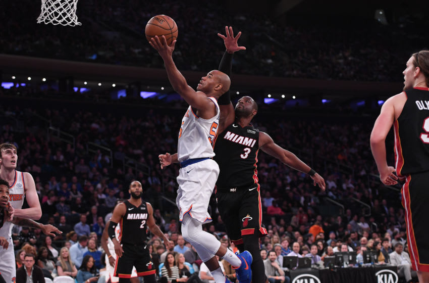 Jarrett Jack #55 of the New York Knicks lays up a shot against Dwyane Wade #3 of the Miami Heat (Photo by Matteo Marchi/Getty Images)