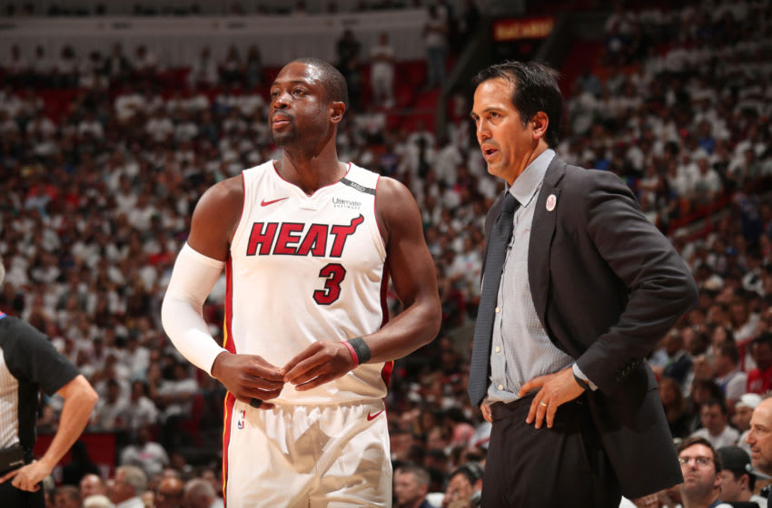 MIAMI, FL - APRIL 21: Dwyane Wade #3 and Head Coach Erik Spoelstra of the Miami Heat look on in Game Four of the Eastern Conference Quarterfinals against the Philadelphia 76ers during the 2018 NBA Playoffs on April 21, 2018 at American Airlines Arena in Miami, Florida. NOTE TO USER: User expressly acknowledges and agrees that, by downloading and/or using this photograph, user is consenting to the terms and conditions of the Getty Images License Agreement. Mandatory Copyright Notice: Copyright 2018 NBAE (Photo by Issac Baldizon/NBAE via Getty Images)