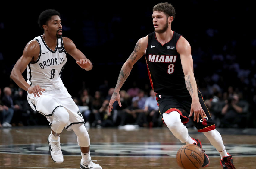 Tyler Johnson #8 of the Miami Heat drives to the basket against Spencer Dinwiddie #8 of the Brooklyn Nets in the first half. (Photo by Abbie Parr/Getty Images)