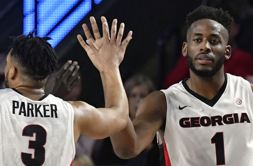 ATHENS, GA - FEBRUARY 17: Yante Maten #1 gives a high five to his teammate Juwan Parker #3 of the Georgia Bulldogs during the Bulldogs' basketball game against the Tennessee Volunteers at Stegeman Coliseum on February 17, 2018 in Athens, Georgia. (Photo by Mike Comer/Getty Images)