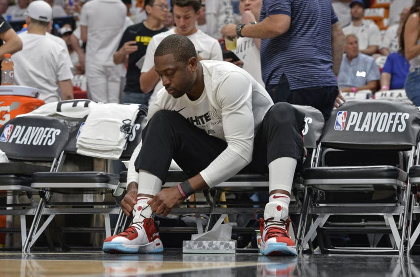 MIAMI, FL - APRIL 19: Dwyane Wade #3 of the Miami Heat ties shoes before the game against the Philadelphia 76ers in Game Three of Round One of the 2018 NBA Playoffs on April 19, 2018 at American Airlines Arena in Miami, Florida. NOTE TO USER: User expressly acknowledges and agrees that, by downloading and or using this Photograph, user is consenting to the terms and conditions of the Getty Images License Agreement. Mandatory Copyright Notice: Copyright 2018 NBAE (Photo by David Dow/NBAE via Getty Images)