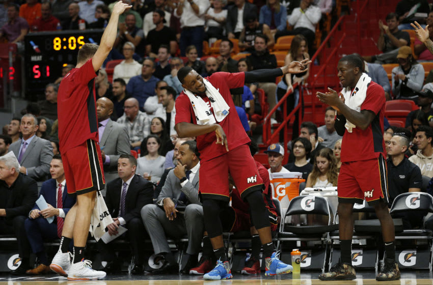 MIAMI, FLORIDA - NOVEMBER 20: Meyers Leonard #0, Bam Adebayo #13 and Kendrick Nunn #25 of the Miami Heat react against the Cleveland Cavaliers during the first half at American Airlines Arena on November 20, 2019 in Miami, Florida. NOTE TO USER: User expressly acknowledges and agrees that, by downloading and/or using this photograph, user is consenting to the terms and conditions of the Getty Images License Agreement. (Photo by Michael Reaves/Getty Images)