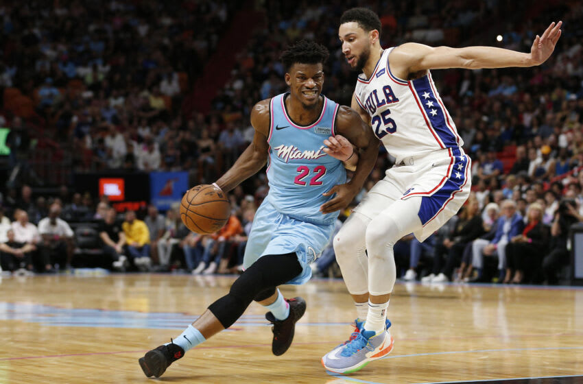 MIAMI, FLORIDA - DECEMBER 28: Jimmy Butler #22 of the Miami Heat drives to the basket against Ben Simmons #25 of the Philadelphia 76ers during the first half at American Airlines Arena on December 28, 2019 in Miami, Florida. NOTE TO USER: User expressly acknowledges and agrees that, by downloading and/or using this photograph, user is consenting to the terms and conditions of the Getty Images License Agreement. (Photo by Michael Reaves/Getty Images)