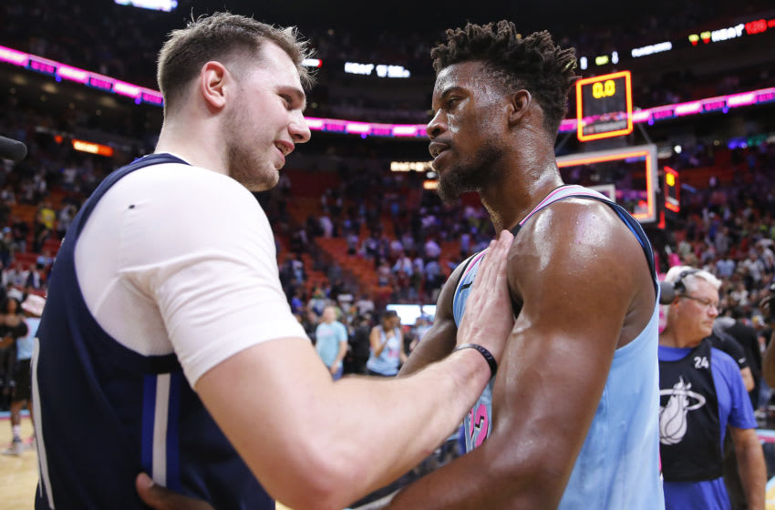 Jimmy Butler #22 of the Miami Heat greets Luka Doncic #77 of the Dallas Mavericks after the game (Photo by Michael Reaves/Getty Images)